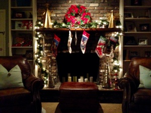 My December bliss? Savoring the simpler moments of the season - like curling up on my sofa with a good book, and this view of our modestly, meaningfully decorated mantel.