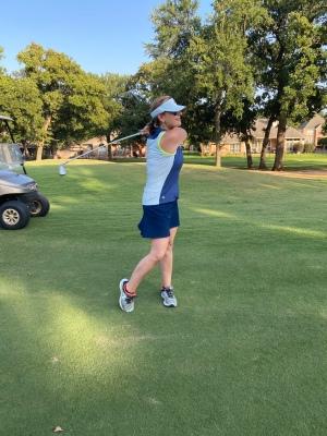 playing golf, swinging a golf club, woman playing golf, new hobby